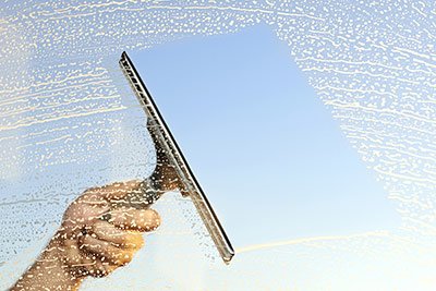 squeegee wiping a window clean