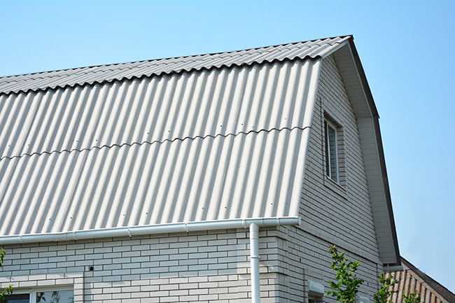 asbestos cement siding on a roof of an old house