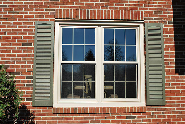 double hung windows on a brick siding wall